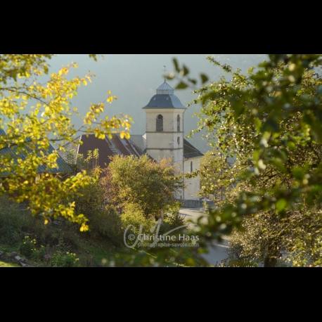 A church in autumn in the French Alps by Christine Haas