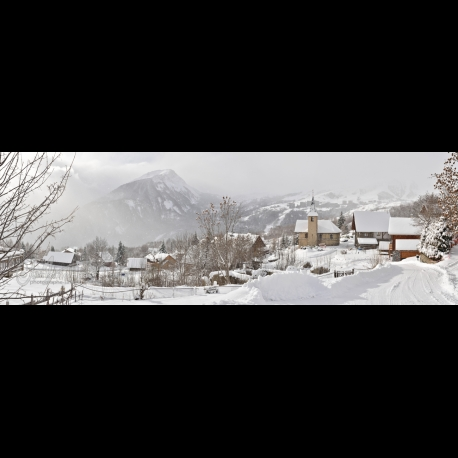 Panoramic photo of a pretty village of Savoie in the snow, above St Jean de Maurienne