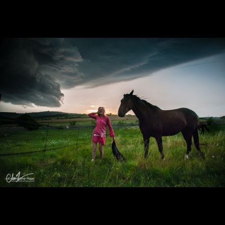 Storm is threatening, Yvonne goes to look after horse anyway